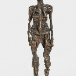 An abstract bronze sculture of a womans body, as seen in a Greek art gallery called Asimis in Santorini