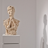 Clay sculpture of upper body, by contemporary greek artist Eleni Kolaitou, of Asimis art gallery, a Greek art gallery in Santorini