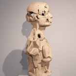 Profile view of clay sculpture, with carvings and hollow areas, by Greek contemporary artist Eleni Kolaitou of the Greek art gallery Asimis, in Santorini