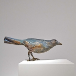 Bronze sculpture of a bird , by Greek contemporary artist Eleni Kolaitou, of the Greek art gallery, Asimis in Santorini