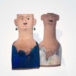 Two abstract clay sculptures inspired by ceramic plank- shaped human figures of the archaic era with contrasting blue and white colours, made by Greek contemporary artist, Eleni Kolaitou