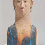 Absract clay sculpture of woman's head inspired by plank- shaped human figures of the archaic era by Greek contemporary artist Eleni Kolaitou of the Greek AK art gallery, Santorini