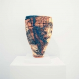 Clay hollow vase, painted with contrasting dark blue and light brown streaks, by Greek contemporary artist Eleni Kolaitou of the Greek art gallery, AK, Santorini Greece.