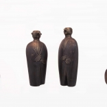 Four differently sized bronze sculprures representing men in suits, produced by Greek contemporary artist Eleni Kolaitou of the Greek art gallery, AK, Santorini