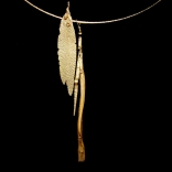 Gold necklace with two long jagged gold pendants by Greek contemporary artist Eleni Kolaitou of the Greek art gallery, AK in Santorini